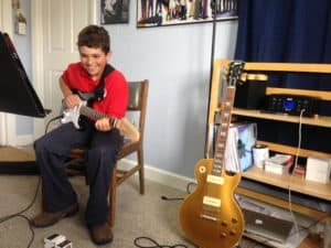 child with electric guitar.